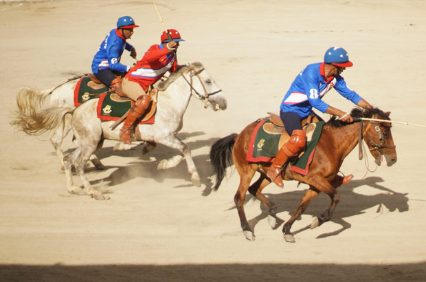 Riders trailing dust during the weekly Sunday Polo Match in Leh, Ladahk